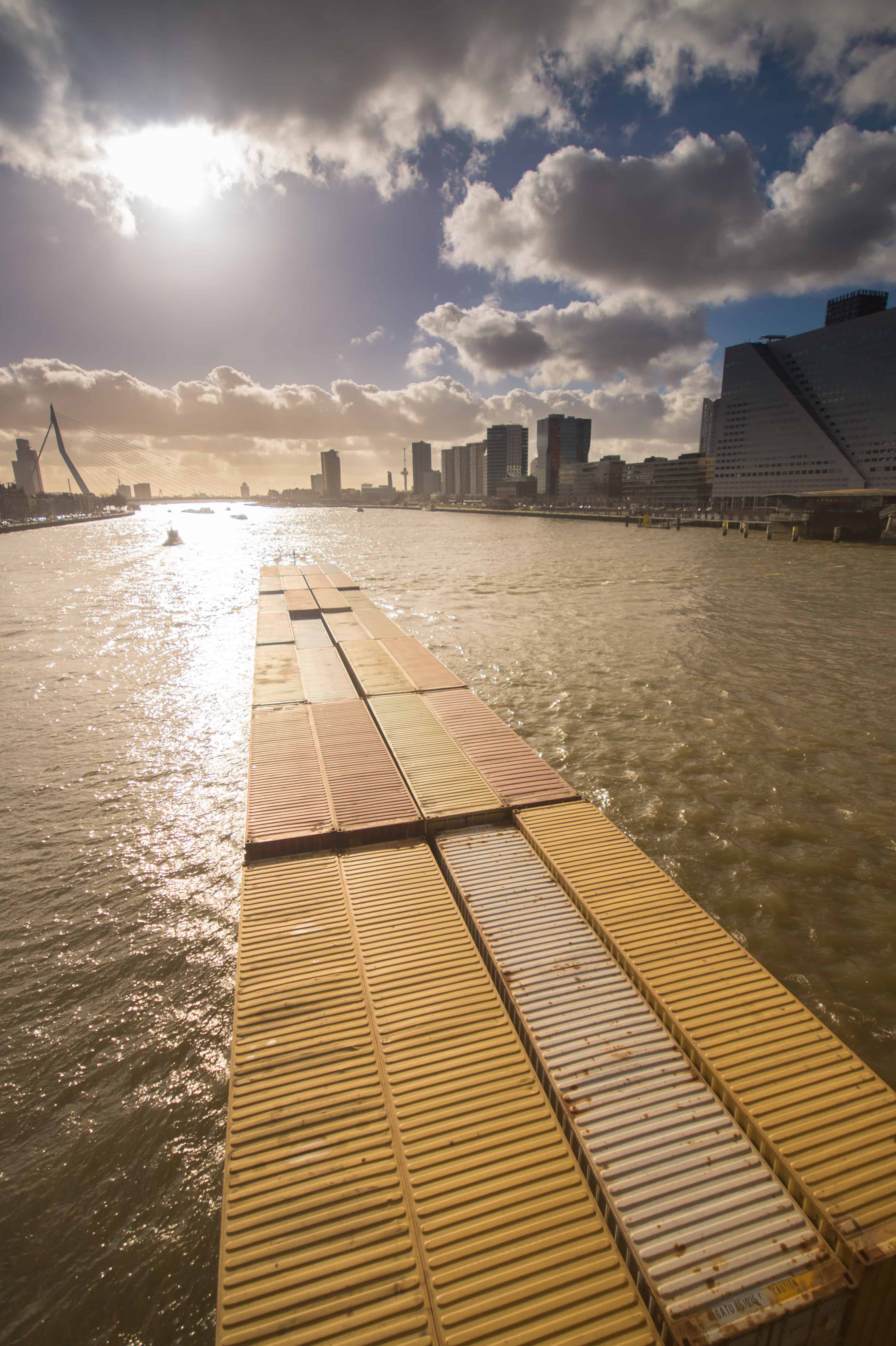 Container barge entering the city of Rotterdam